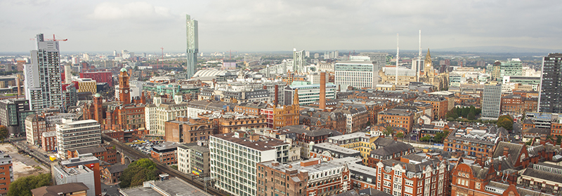 Aerial view of Sackville Street Building with Manchester skyline in the background aerial