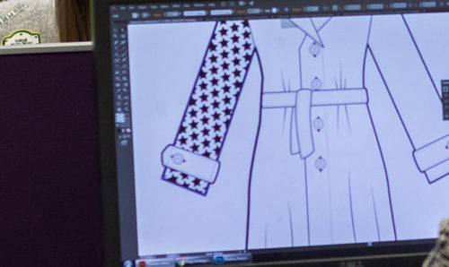 Student working on fashion designs on screen
