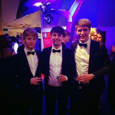 Sam, Harry, and a friend at a University ball