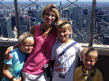 Aline and her children at the Empire State Building