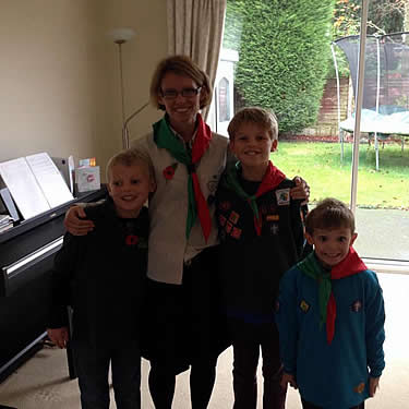 Aline and her children getting ready for Beaver Scouts!