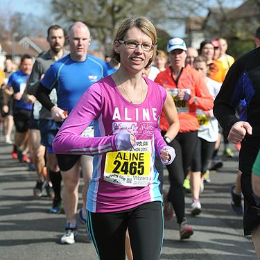 Aline running the Wilmslow half