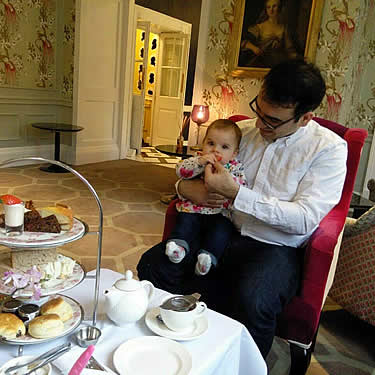 Nima and his daughter enjoy a spot of afternoon tea