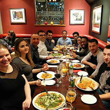 Nima and his research group take a break and go for a meal