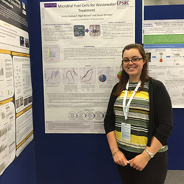 Emily presents her research in poster form