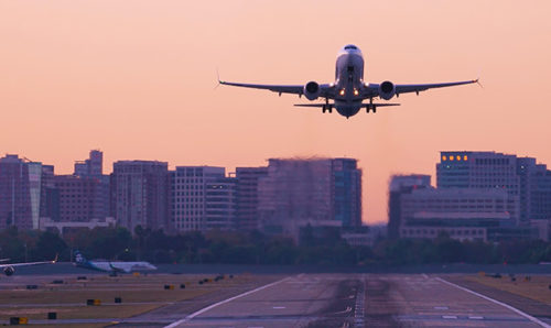 Airliner taking off at sunrise