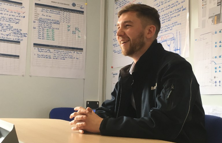 Evan Smith smiling in Balfour Beatty offices on MECD site