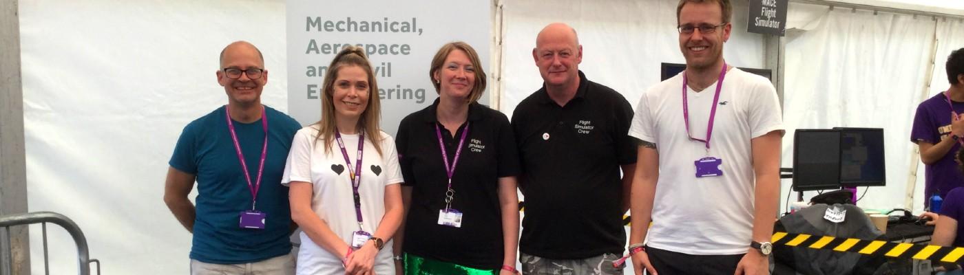 Women in engineering: Natalie Parish (centre) with MACE SR and flight sim team at Bluedot Festival