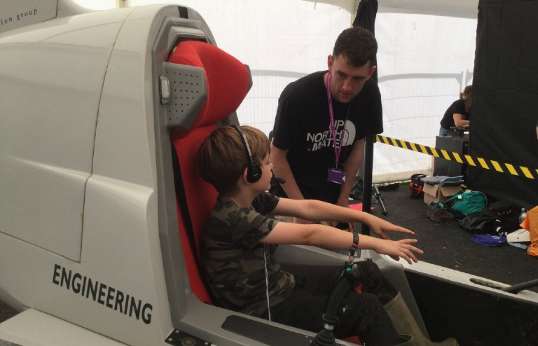 John Gavaghan operating the flight sim at Bluedot Festival