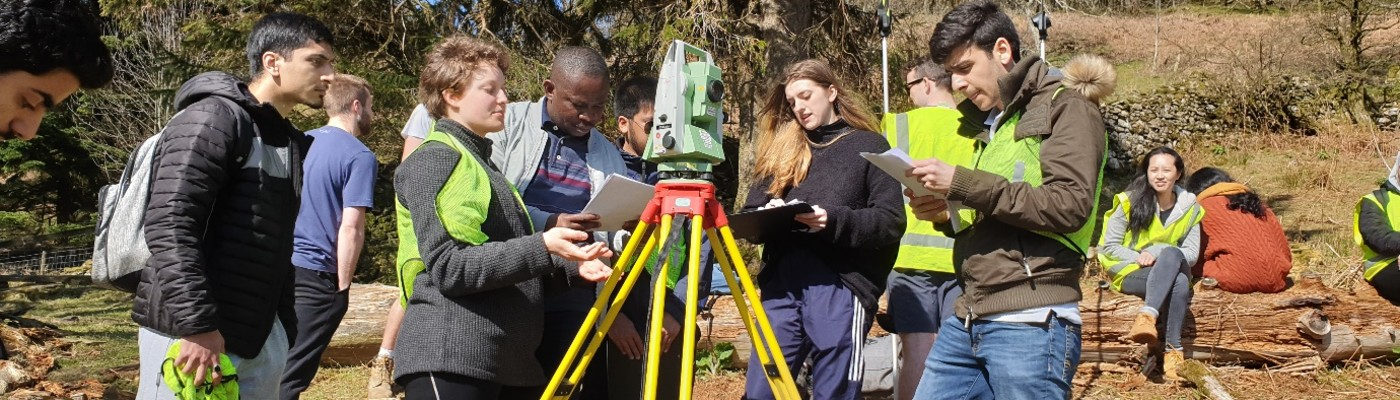 Civil engineering students taking measurements on a field trip to Patterdale, Cumbria