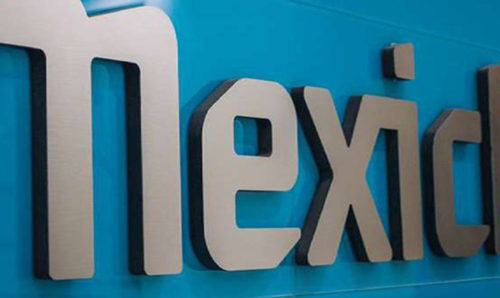 Mexichem logo on blue office wall