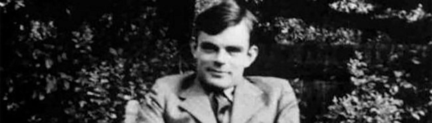 Alan Turing smiling at the camera