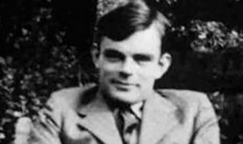 Alan Turing smiling at the camera