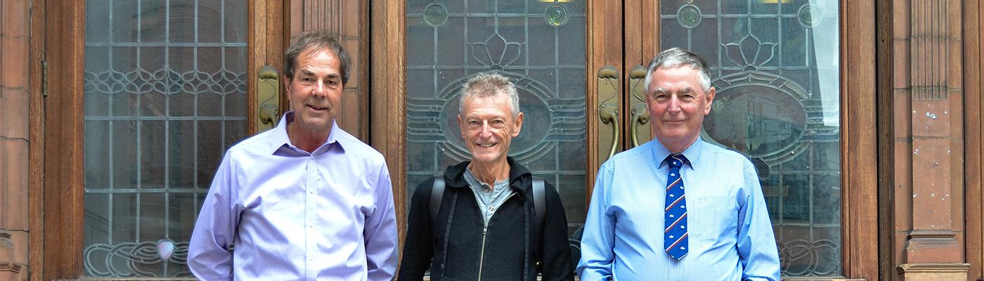 The three men outside Sackville Street Building