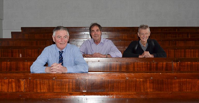 The three men in a lecture theatre