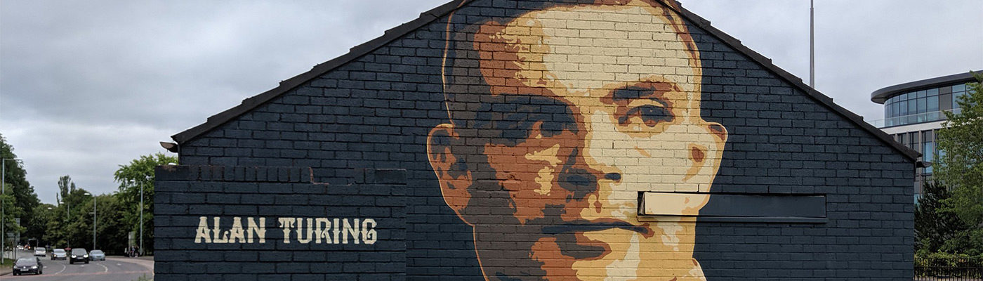 Alan Turing mural on the side of a building