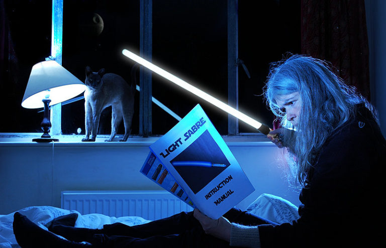 Woman in bed with lightsaber instructions