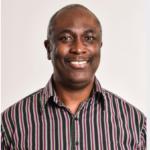 Man in striped shirt smiling