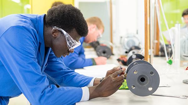 Black male scientist in lab coat