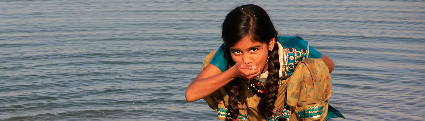 Girl drinking water in India