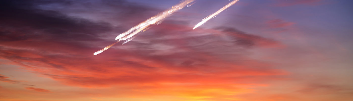 Meteorites in a colourful sky