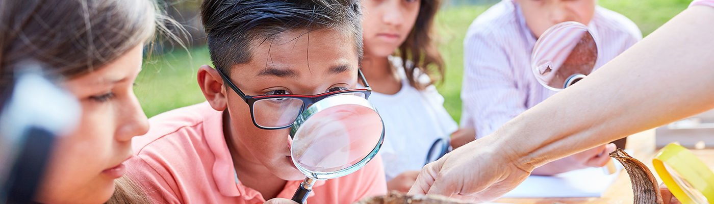 Children using a magnifying glass