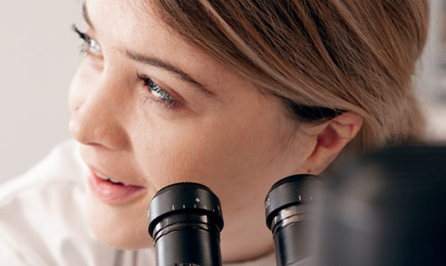 Woman scientist with microscope