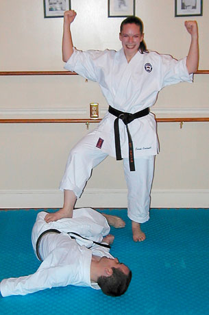 Sarah 'defeating' her husband during karate training. The photo was taken by David Gomez, her karate instructor in the USA.