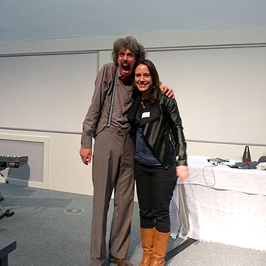 Sarah posing with 'Einstein' while speaking at the Manchester Science Festival
