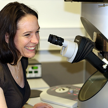 Sarah looking particularly happy while sitting at her microscope!